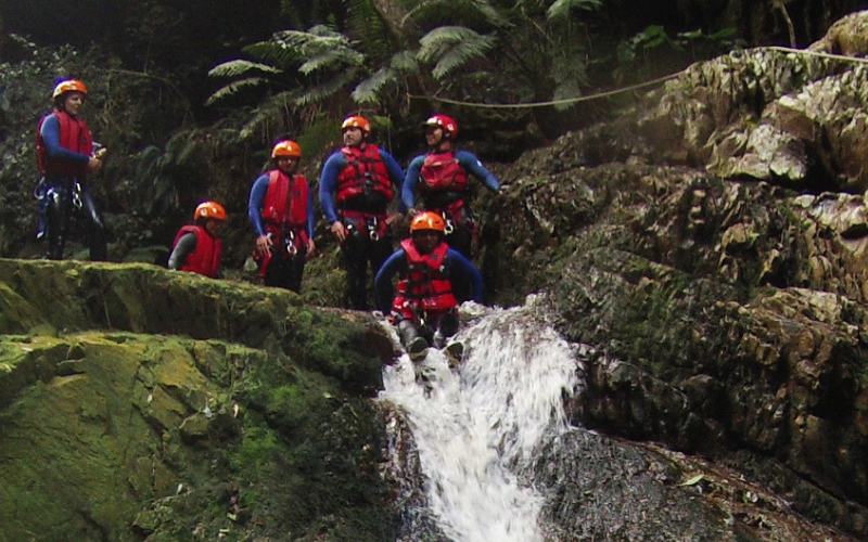 group of people canyoning