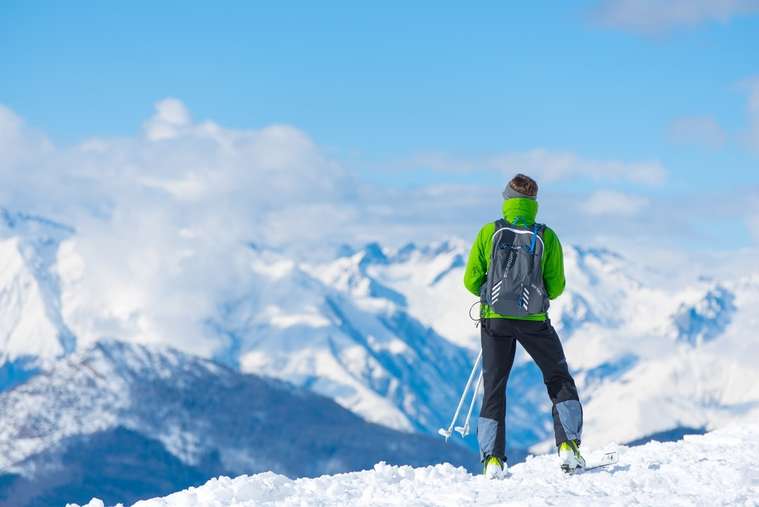 skiier in the mountains in snow