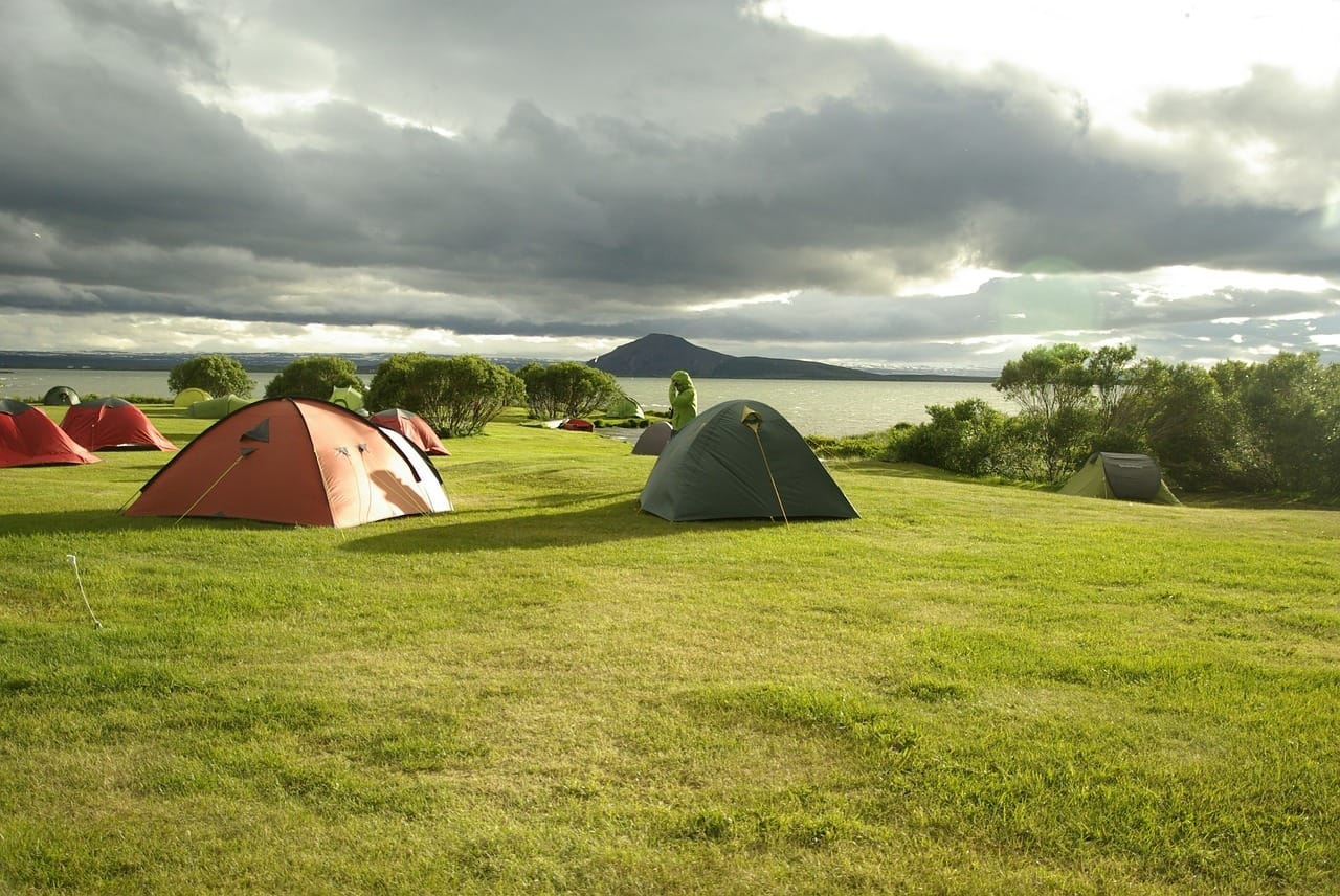 Camping Tents on a Grass Field