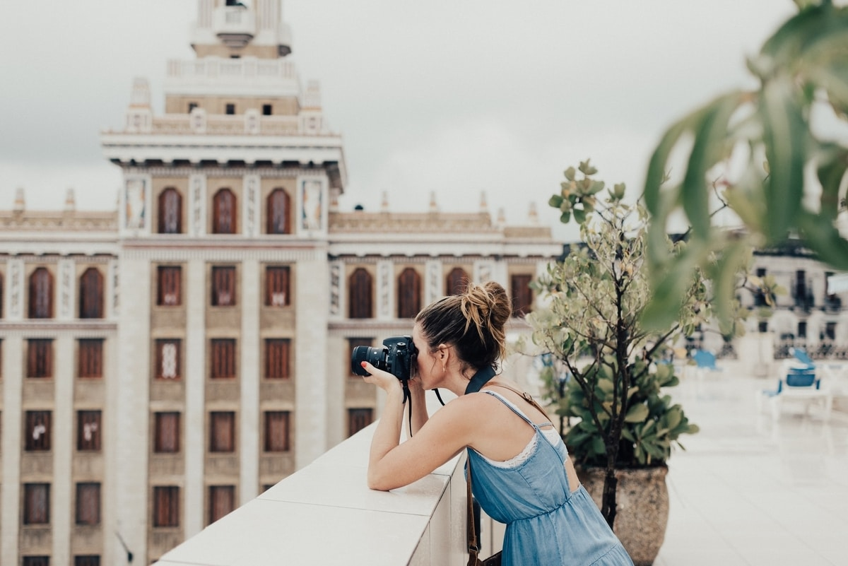 girl-taking-picture-with-camera-in-cuba