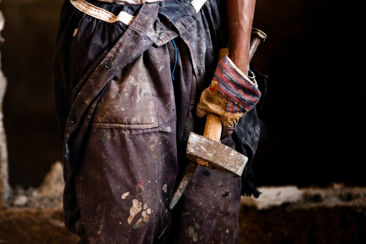 man-holding-hammer-and-chisel