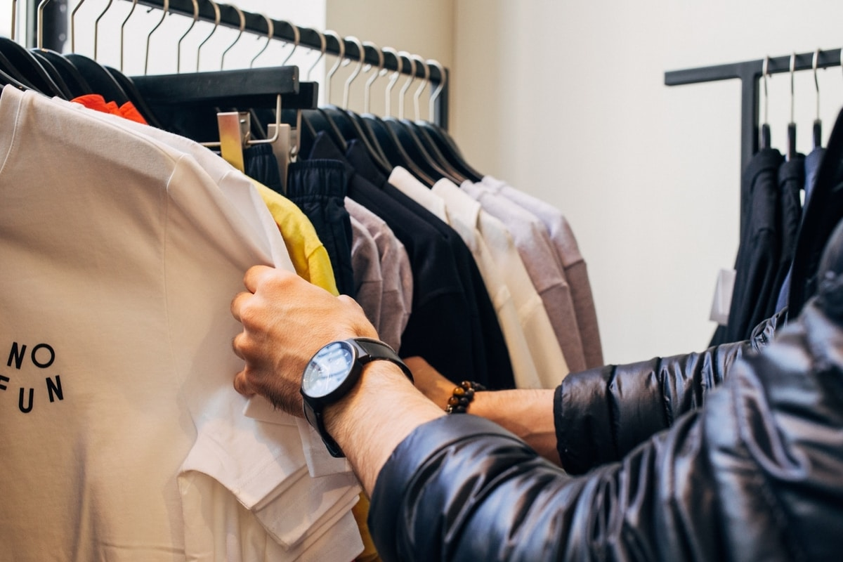 man-scanning-clothes-on-a-rail
