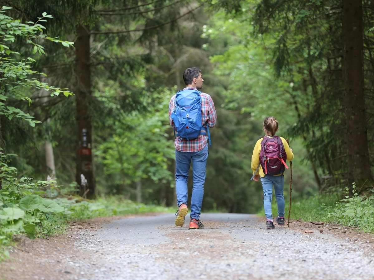 Man and daughter hiking